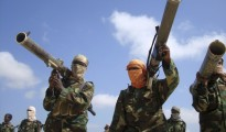 Members of the hardline al Shabaab Islamist rebel group hold their weapons in Somalia's capital Mogadishu