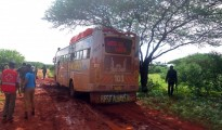 A medical worker and security forces walk near a bus that was ambushed by al-Shabab gunmen who singled out and killed 28 non-Muslim passengers in Kenya's northern Mandera County, Nov. 22, 2014. The Islamic militant group is suspected of again attacking a Kenyan bus and trying to separate Christian from Muslim passengers. PHOTO: STRINGER/AFP/GETTY IMAGES