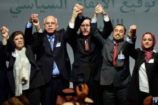 """Libya's General National Congress (GNC) deputy president Saleh al-Makhzoum (2ndR), the new national government head, Prime Minister, Fayez al-Sarraj (C) and the head of the Tobruk-based House of Representatives Mohamed Ali Shoeb (2ndL) celebrate after signing a deal on a unity government on December 17, 2015, in the Moroccan city of Skhirat. Rival Libyan politicians signed a deal on a unity government despite opposition on both sides, in what the United Nations described as a """"first step"""" towards ending the crisis. AFP PHOTO / FADEL SENNA / AFP / FADEL SENNA"""