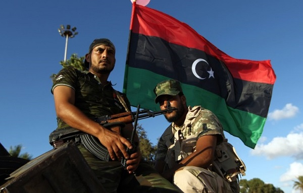 "Libyan troops loyal to Khalifa Haftar, a retired general and former chief of staff for Moamer Kadhafi, sit on an amoured personnel carrier (APC) during a demonstration calling on the international community to arm the Libyan army on August 14, 2015 in the eastern Libyan city of Benghazi. The Tobruk-based government (recognised by the international community) said in a statement that world powers were using ""double standards"" by fighting IS in Syria and Iraq and ""turning a blind eye"" to the presence of the jihadists in Libya. AFP PHOTO / ABDULLAH DOMA"