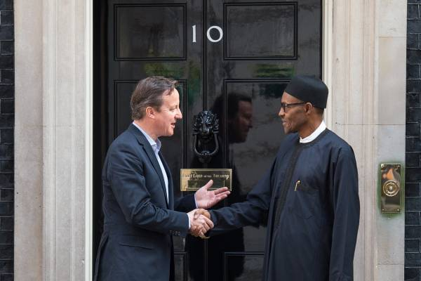 Britain's Prime Minister David Cameron (L) shakes hands with Nigeria's President-elect Muhammadu Buhari following a meeting in Downing Street, central London on May 23, 2015. AFP PHOTO / LEON NEAL (Photo credit should read LEON NEAL/AFP/Getty Images)